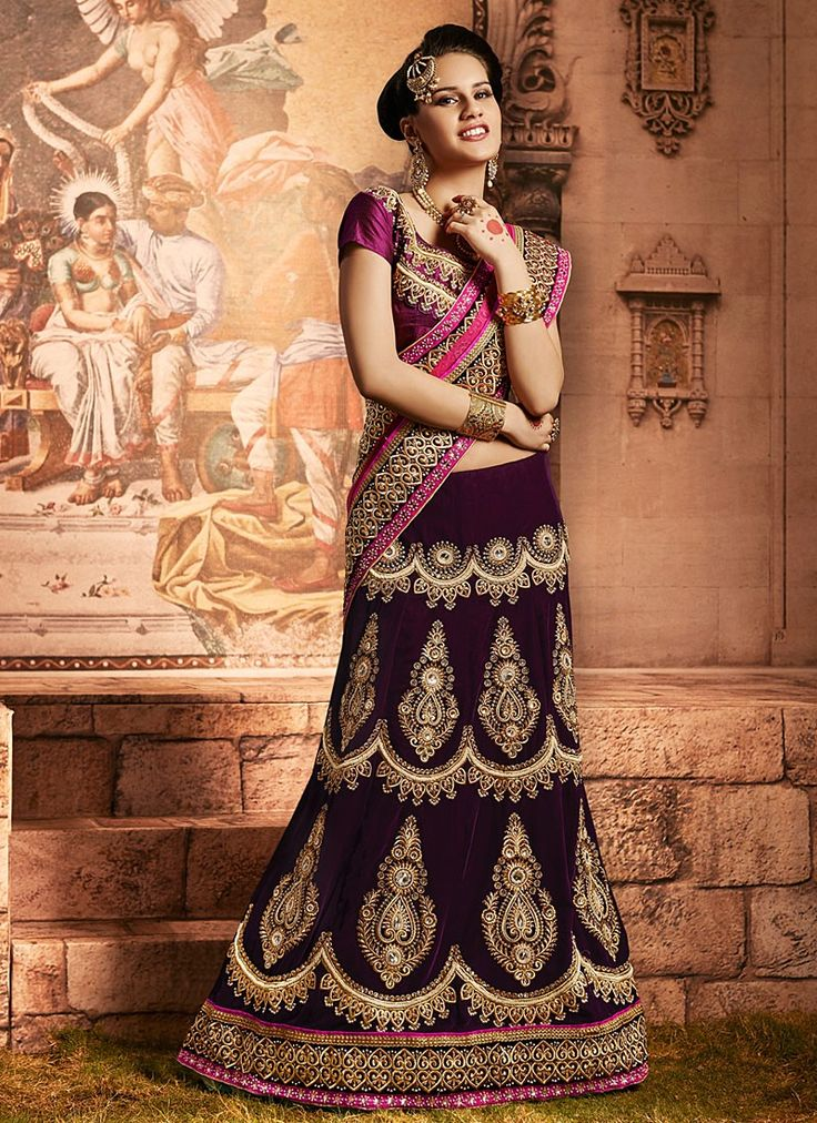 Shop this product from here.. http://www.silkmuseumsurat.in/purple-stone-enhanced-velvet-lehenga-choli?filter_name=4636  Iem :#4636  Color : Purple Fabric : Velvet Occasion : Bridal, Party, Reception, Wedding Style : A Line Lehenga Work : Applique, Embroidered, Kasab, Patch Border, Resham