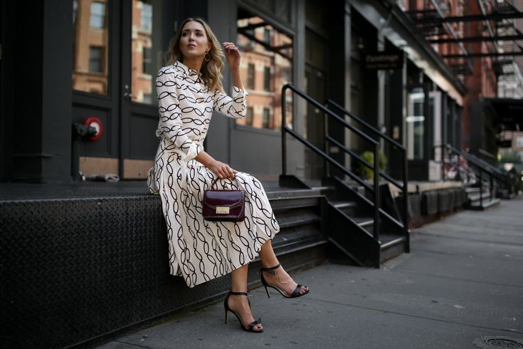 burgundy tory burch juliette bag black and white pleated midi skirt chain print shirt black alexandre birman ankle strap bow sandals nyc style fashion blogger