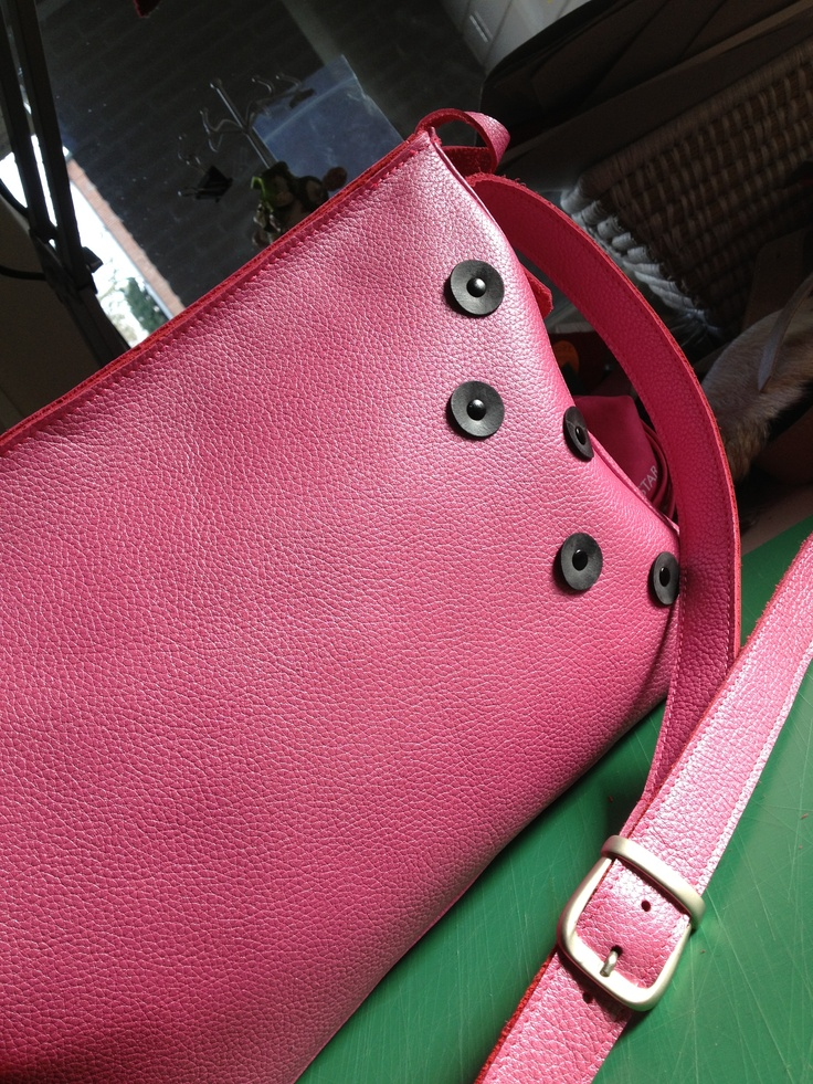Leather bag, decorated with buttons, made of bicycle innertubes