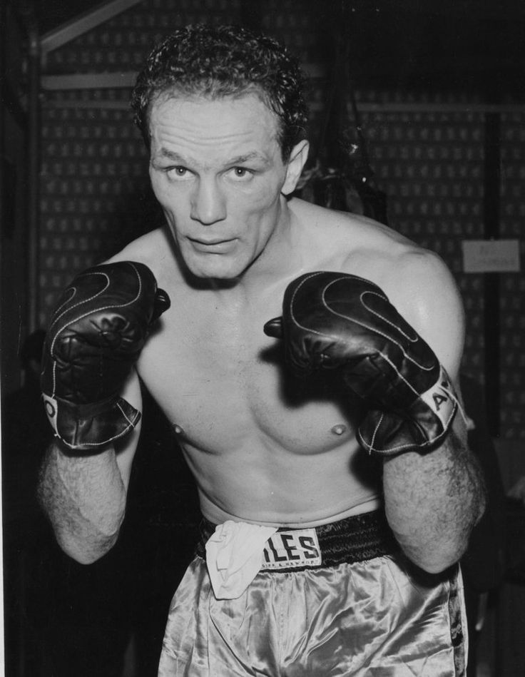 British Heavyweight Boxing Champion Henry Cooper pictured in shorts and gloves posing in a fight position for the camera. He had been training for his fight against Joe Erskine for the British title on November 17th 1959.
