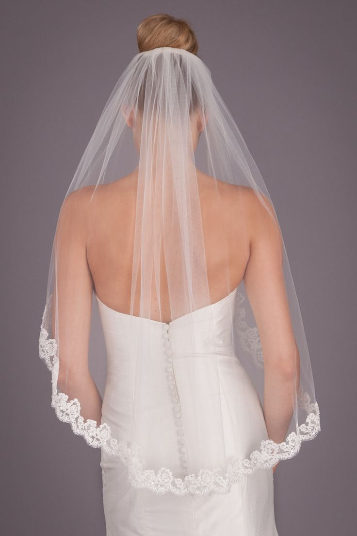 A lovely bridal veil with a delicate, detailed lace edging.   Kennedy Blue Mila
