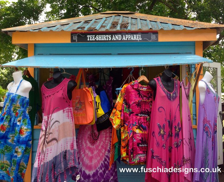 A colourful street stall selling clothes and jewellery on the way to St Lawrence Gap by www.fuschiadesigns.co.uk.