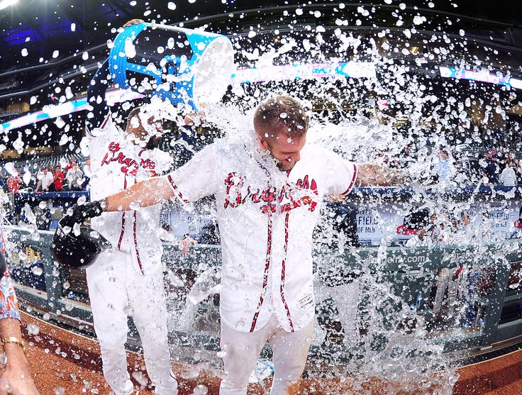 ATLANTA, GA - MAY 23: Matt Adams #18 of the Atlanta Braves is doused by Matt Kemp #27 with the water cooler after knocking in the game-winning run in the ninth inning against the Pittsburgh Pirates at SunTrust Park on May 23, 2017 in Atlanta, Georgia. (Photo by Scott Cunningham/Getty Images)