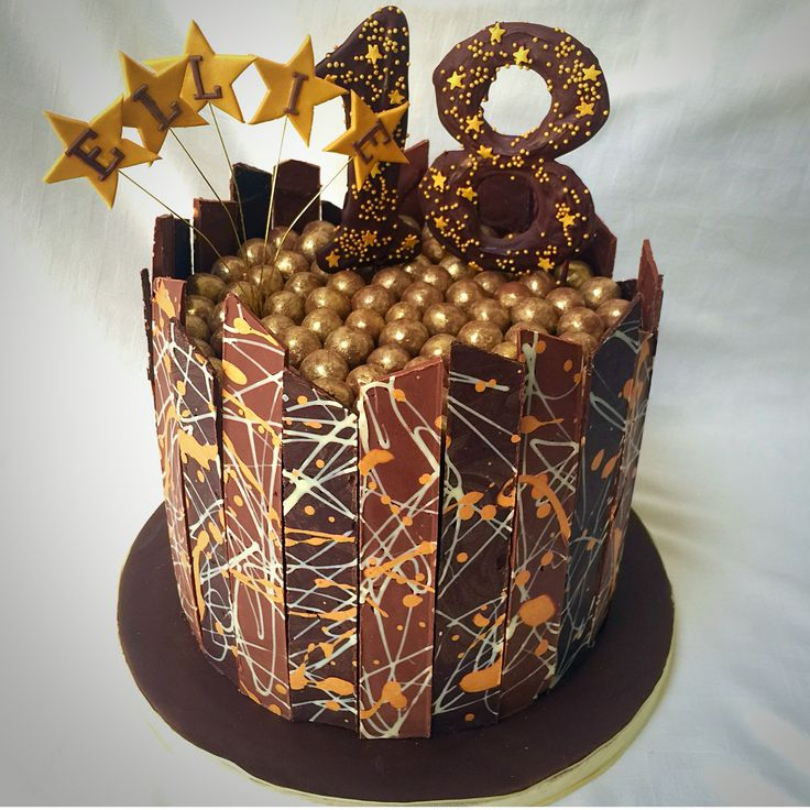 Chocolate shard cake topped with folds maltesers chocolate number and bopper starburst name