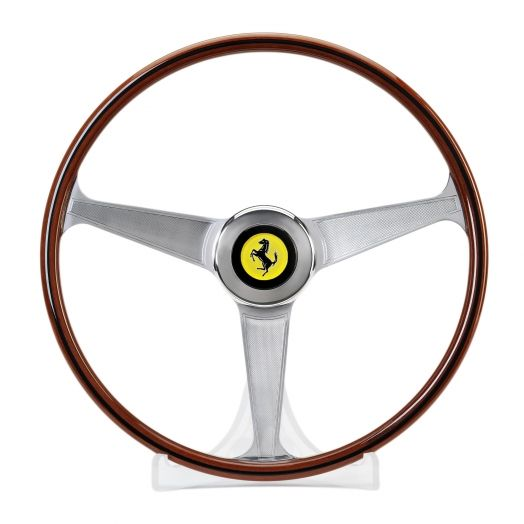 Ferrari 1959-65 Steering Wheel - LIMITED EDITION. This collectible item is a 1:1 scale reproduction of the classic goblet-shaped wheel produced by Nardi, which was installed on Ferrari cars from 1959 to 1965. True Ferrari car enthusiasts will appreciate this one for sure.