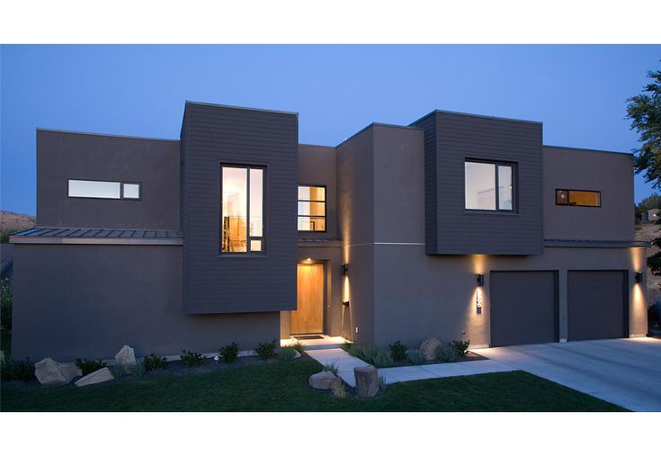 Exterior View Of The Front Of The House At Twilight Contemporary Modern Residential House