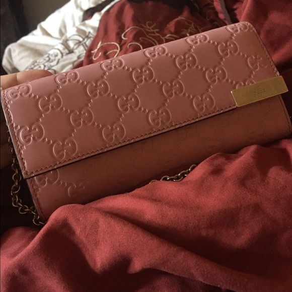 Baby pink chained AUTHENTIC GUCCI wallet!! SALE!! Baby pink, imprinted Gucci signs, brand NEW wore a couple of times. Bought from Gucci store at the Beverly Center. Gucci Bags Wallets