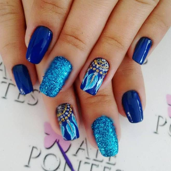 Stunning dream catcher blue nail design