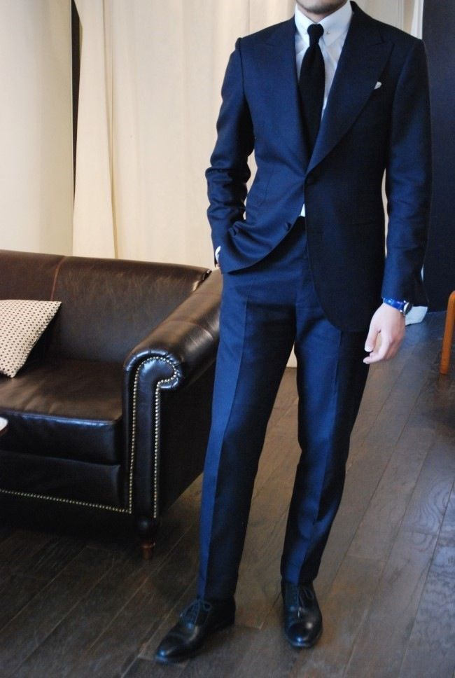 blue suit, white shirt and black tie