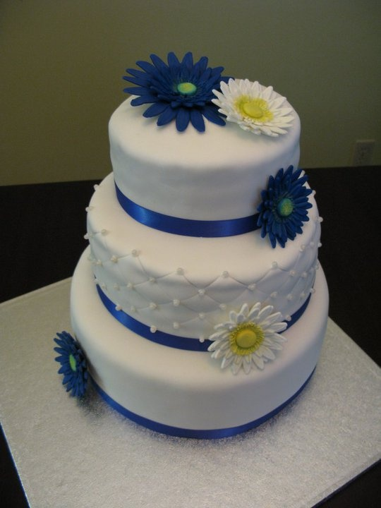 Top tier - carrot cake with cream cheese filling Middle tier - white cake with lemon filling Bottom tier - chocolate cake with chocolate filling