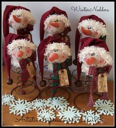 Winter Nodders are crafted using rusty beehive bed springs. Each nodder wears a faux suede stocking cap trimmed with coffee stained faux Monoglian fur and a large rusty jingle bell. His collar is also crafted from faux Mongolian fur and trimmed with a homespun bow, rusty jingle bell and gungy hang tag. $18 each