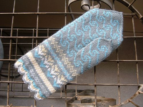Latvian-style mittens with an oceanic feel -- the sun plays on and under the water, illuminating the sea flora beneath. Wave patterns and muted colours throughout evoke a sense of calm that only the oceans can provide.