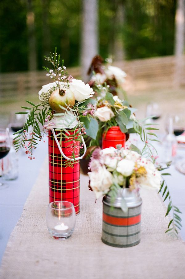 flowers in plaid thermoses as centerpieces, photo by Jenna Henderson http://ruffledblog.com/campfire-wedding-inspiration #weddingideas #centerpiece #campwedding