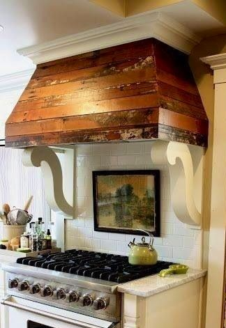 love the decorative brackets! range hoods - http://www.motorhomepartsandaccessories.com/motorhomerangehoods.php