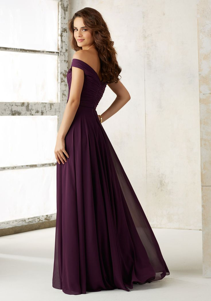 Morilee by Madeline Gardner Bridesmaids Style 21523 | Off-the-Shoulder Ruched Bodice and Flowy Chiffon Skirt Bridesmaids Dress Creating a Classic, Elegant Look. Zipper Back. Shown in Eggplant