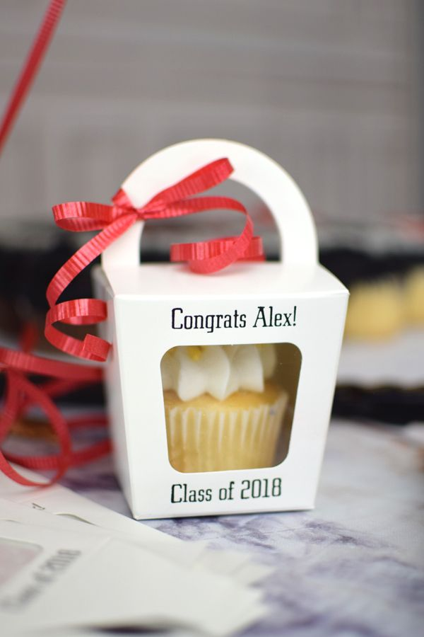 A cute way to display graduation cupcakes instead of on a tower.  Tote your graduation cupcakes in cute cupcake boxes with handles and give guests an easy, take-home favor they will actually love. And since they are in boxes, guests don't have to eat their cupcake right away.  They can save it for a late night snack.