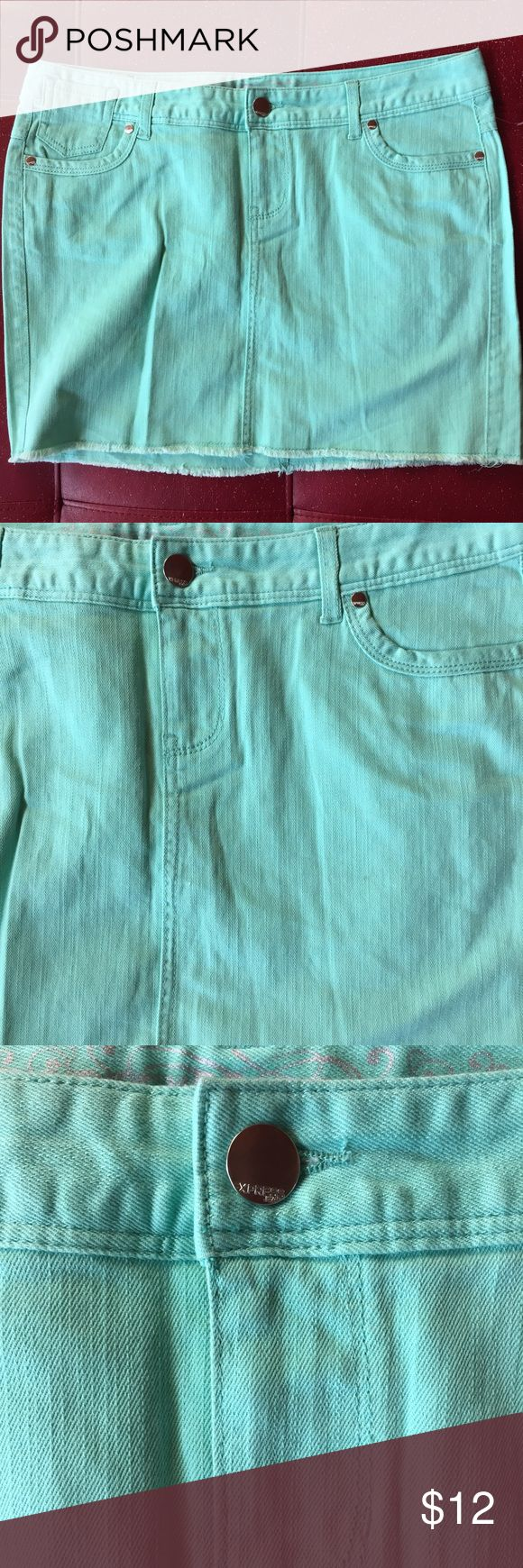 Teal Jean mini Skirt Super cute and colorful teal mini denim skirt. Great condition. Express Skirts Mini