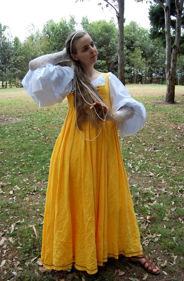 A fantasy outfit made for a character in a fairytale popular in the 15th century in the Italian states. The yellow dress is historically accurate but the rest isn't. Camicia sleeves wern't that big yet and they weren't worn short or without sleeves over them.