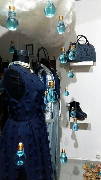 Autumn window display in Salamis, Greece. The light bulbs are hanging from a large cloud and they are filled with light blue water to resemble rain drops. Brilliant!