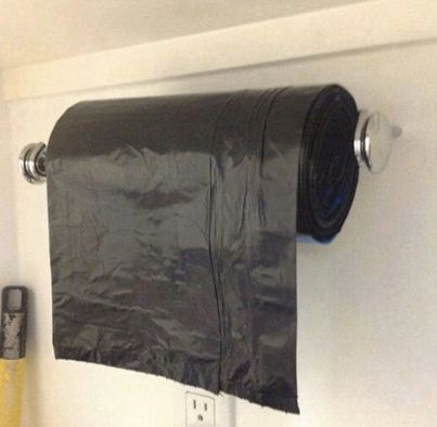 Savings Tip: Use a towel bar to make accessing garbage bags easier!