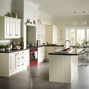 Example of white units, black worktops and white/cream accessories. Timeless.