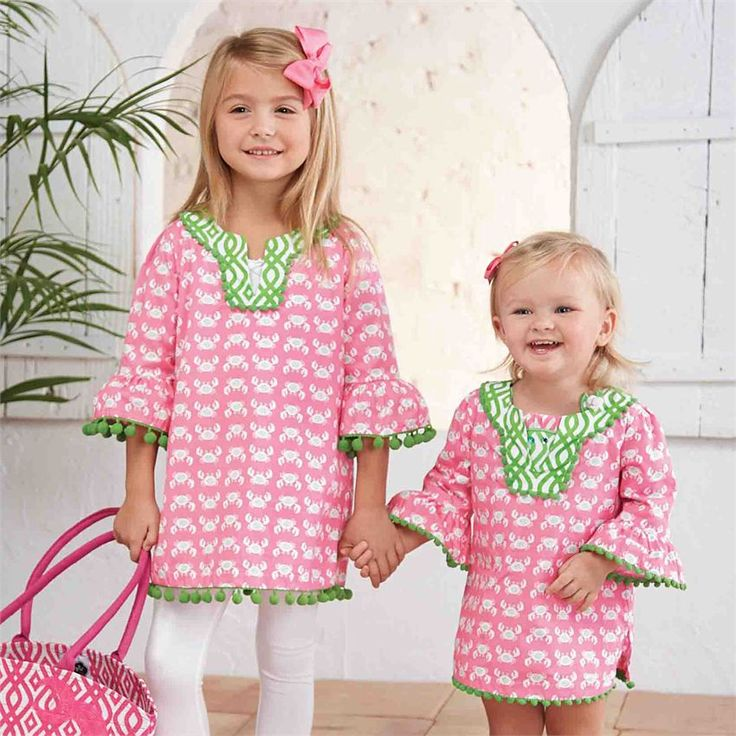 Printed cotton tunic features pom-pom trim and contrasting print at neck. Can be worn as a dress, tunic or swim suit cover up. #MudPieGift