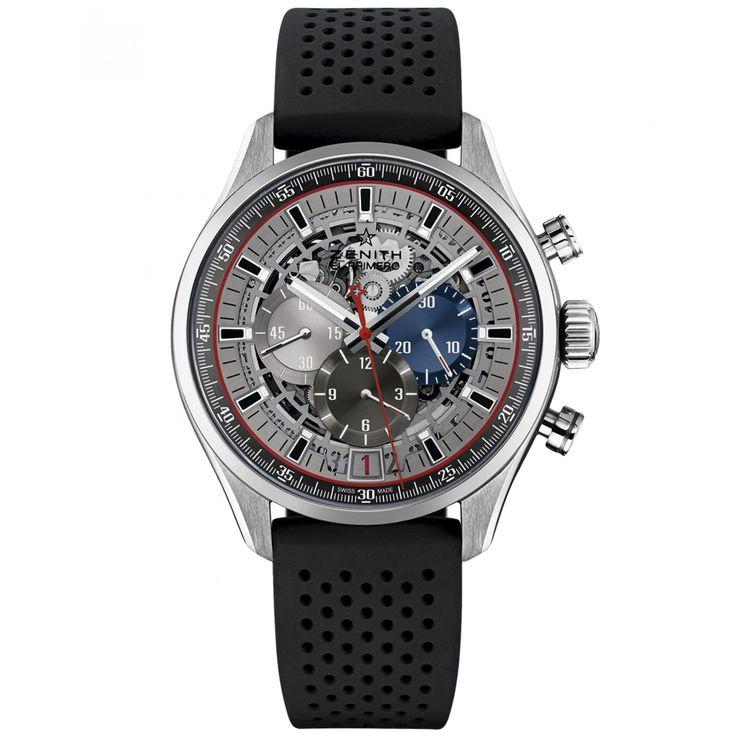 Reloj Zenith de caja y bisel en acero; extensible tipo correa en caucho color negro carátula con mecanismo visible manecillas e indicadores luminiscentes y nombre de la marca.