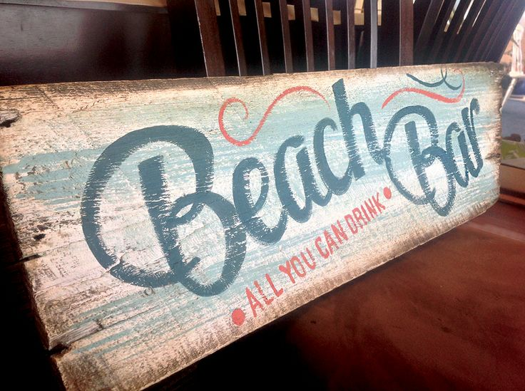 "Distressed wooden Beach Bar sign. 3 feet wide by 9"" high. This sign angles off on the right side like a directional sign. I also Have one that doesn't angle off. $80"