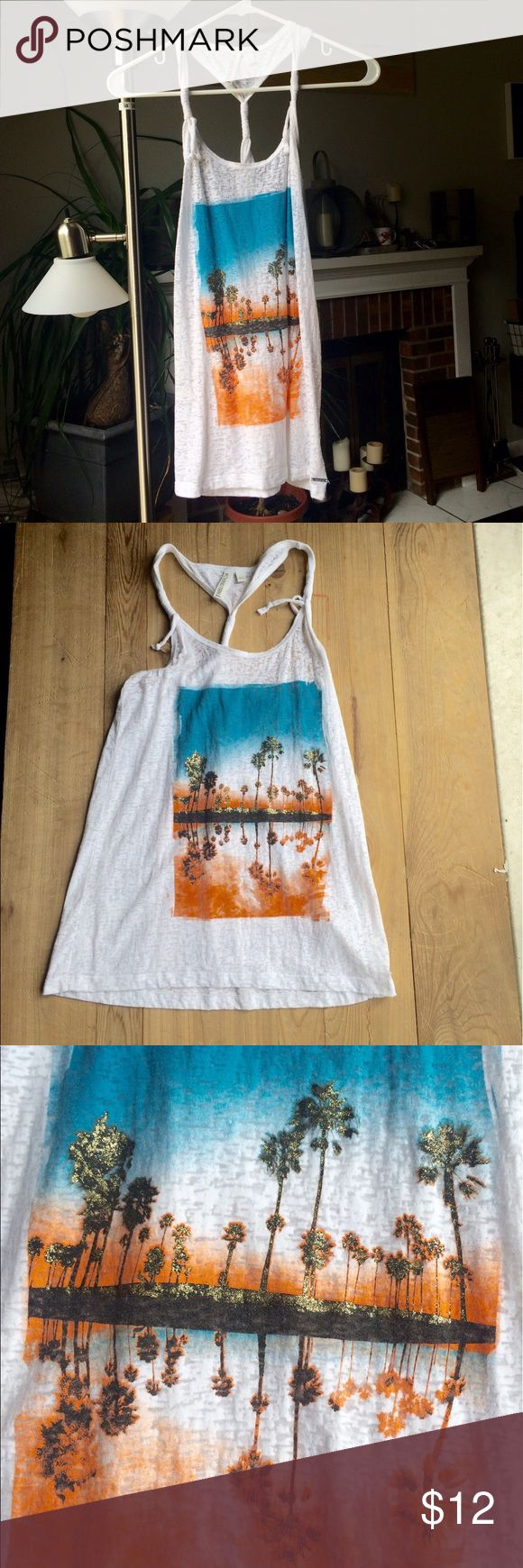 Hangten racerback twisted tank Best worn with a bandeau and an attitude, the blue and orange palm trees glitter with gold and begs to be worn on a warm summer night. Light material with a twisted back and tassel straps. Can be dressed up with skinny jeans, heels, and a moto jacket or can be worn for Gym, Tan, Laundry. Hang Ten Tops Tank Tops