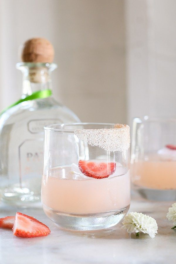 The Sweet Naïveté // Strawberry and almond is the best combo! @Patron is traveling the world, stopping at major cities with their mobil cocktail lab! They've curated recipes for each city and we're sharing the The Sweet Naivete! It's the perfect cocktail to sip on by the beach! It's citrusy, fruity and refreshing. Recipe on Sugar and Charm! #PatronTheSummer#Sponsored