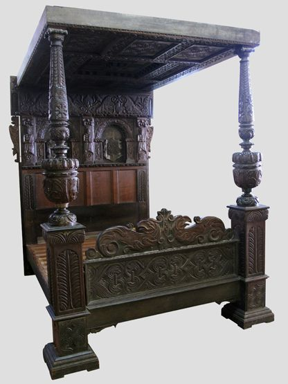 """PART 17TH CENTURY OAK FOUR POSTER BED, the panelled and heavily carved head with term figures, panelled and strapwork moulded roof, massive carved and moulded cup and cover pillar supports to the foot with a moulded and carved panel. Together with mattress. 70"""" Wide max x 87"""" max.   CONDITION REPORT;  Some panelling is period 17th century, mostly Victorian. Estimate: £1,500 - £2,500  -mt"""