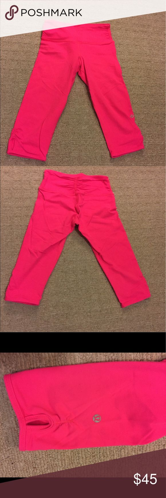 Lululemon neon pink crop leggings (sz2) Size 2 lululemon crop leggings in a bright neon pink. Keyhole details on each leg and scrunch detailing at waist and in back. Very flattering! lululemon athletica Pants