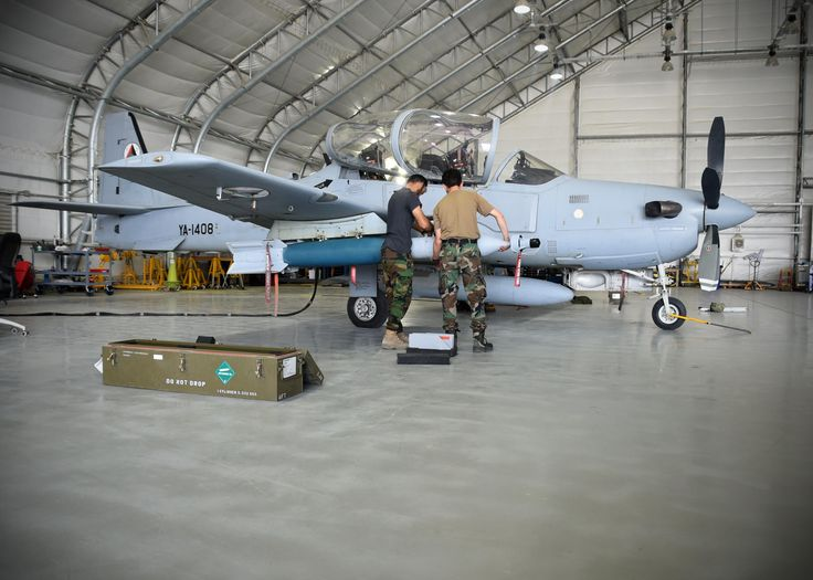 Two Afghan Air Force A-29 Super Tucano maintainers download GBU-12s on July 26, 2017, at Kabul Air Wing, Afghanistan. Recently, AAF A-29 maintenance leaders requested to take full responsibility for flightline maintenance operations from Train, Advise, Assist Command-Air advisors and contract maintenance. USAF photo by TSgt. Veronica Pierce.