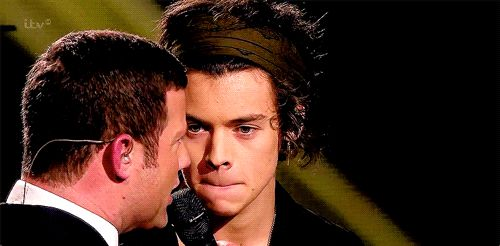 He looks like hes determining whether he should beat up the guy or not. And then hes like uhhh better not @Harry Styles
