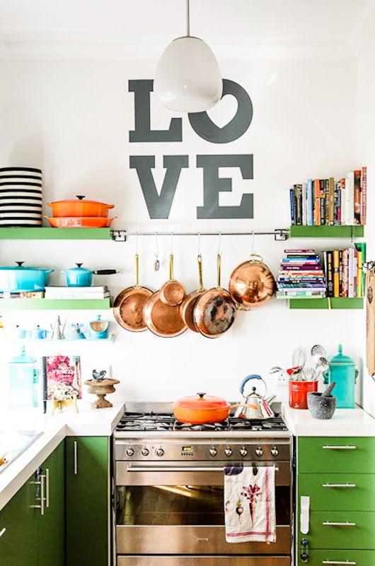 Organize This: Small Kitchen Spaces! I love the wall words, the copper cookware and the color of the cabinets! I want it all