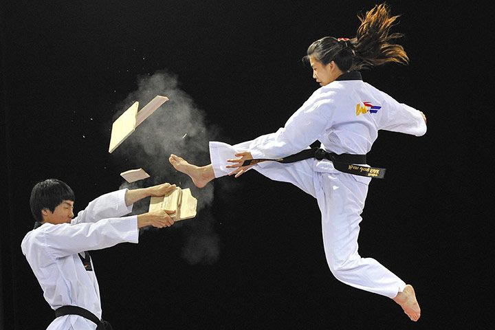 Members of a Taekwondo display team demonstrate one way to deal with the frustrations of putting together flat pack furniturePhotograph: Toby Melville/Reuters