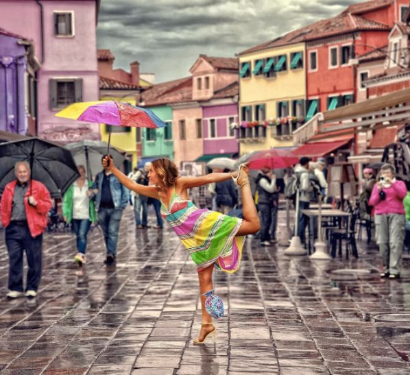 THE EURO SERIES |  I could have held the umbrella with my vagina, but I would have made a spectacle of myself.  On the stunning and surreal island of Burano, outside of Venice, Italy, with Murano glass vase.  #vaginalkungfu #poweredbyvagina  #venice #italy