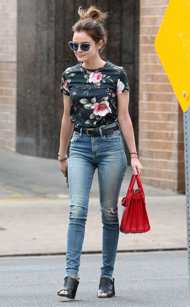Lucy Hale adds some style to everyday errands with dramatic cat-eye shades and a sweet floral shirt.