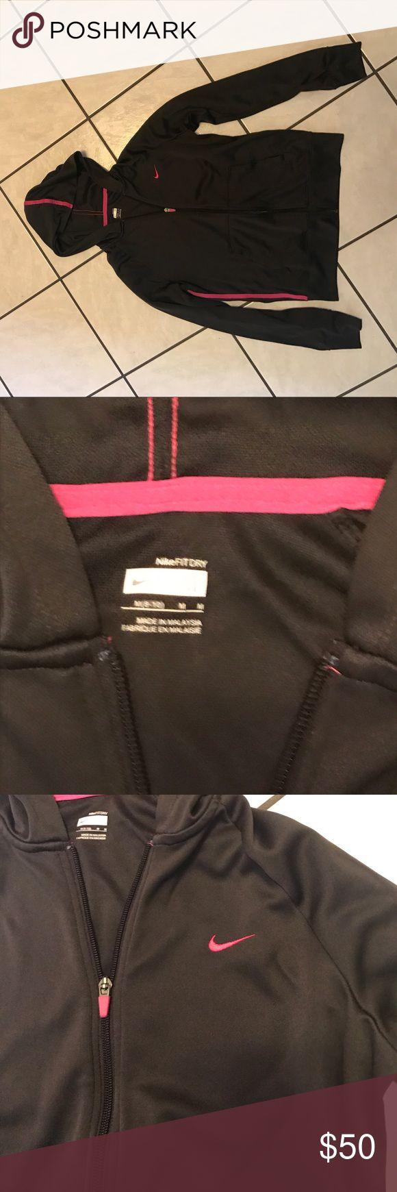Nike zip-up hoodie •NWOT• size M Nike zip-up hoodie •NWOT• size M• brown with pink stripes on side, hood, and pink check Nike Tops Sweatshirts & Hoodies
