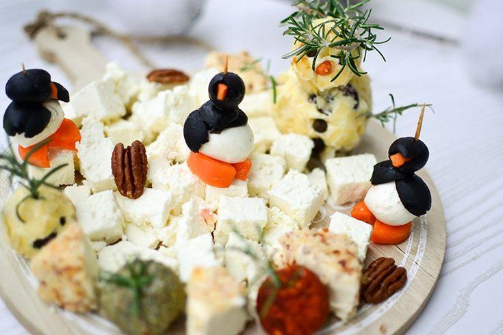 Cheeseplate with Butter Frosty and Black Olive Penguins. Käseplatte mit einem Frosty aus Butter und Pinguine aus schwarzen Oliven