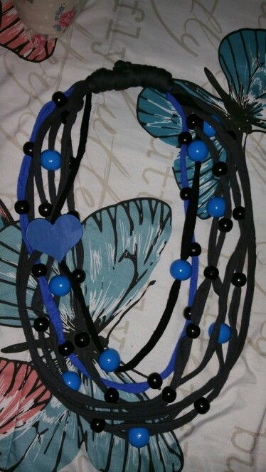 Grey strings with blue heart.