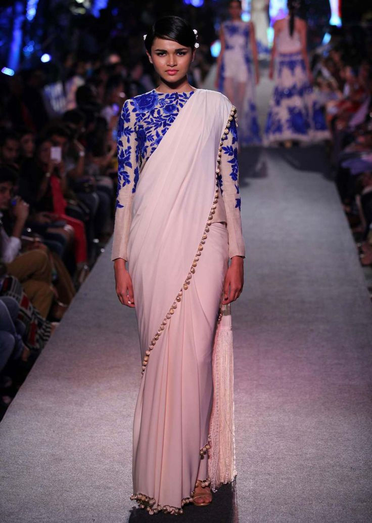 Model walks the ramp in cream saree with full sleeve embroidered blouse for Manish Malhotra Blue Runway collection at Lakme Fashion Week Summer Resort 2015 - Kalkifashion.com