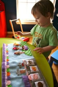 I love Felt Books (Quiet Books)  And kids 2 and up love them as well (My pre-schoolers LOVE THEM and sit forever with them)  Great language tool.  Patterns on how to make your own!