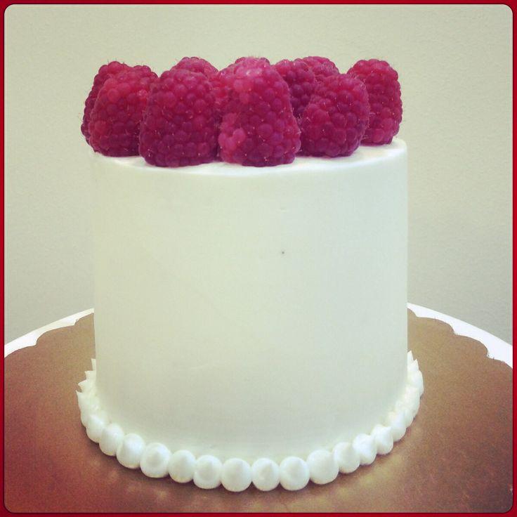 Mini cake chocolate and raspberries.