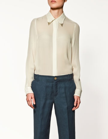 obsessed with this white shirt, western chic. silver points. mmmm.