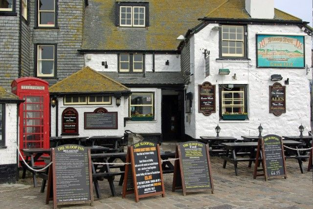 One of Cornwall's oldest and most famous Inns, favourite haunt of locals, fishermen, artists and tourists all year round. Believed to date from about 1312 A.D., the Sloop Inn is situated right on the harbour front at St Ives with only a cobbled forecourt and road separating it from the sea. All of the beaches, shops and art galleries, including the Tate Gallery, are within easy walking distance.    The Sloop Inn, with its low open beamed ceilings and slate floors in the bars, has retained…
