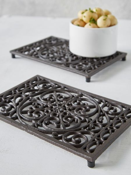 This fabulous heavy rectangular cast iron vintage trivet is ideal for the busy kitchen.