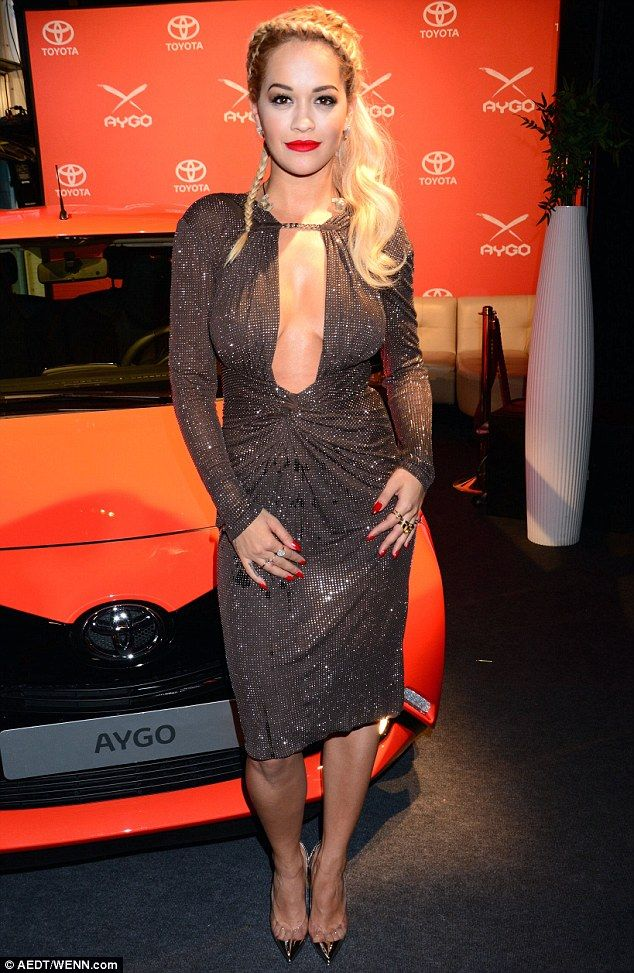 Rita Ora wears preciously low-cut sparkly dress ...