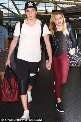 David Beckham's son, Brooklyn holds hands with gf Chloe Grace Moretz after a romantic trip (photos) - http://www.thelivefeeds.com/david-beckhams-son-brooklyn-holds-hands-with-gf-chloe-grace-moretz-after-a-romantic-trip-photos/