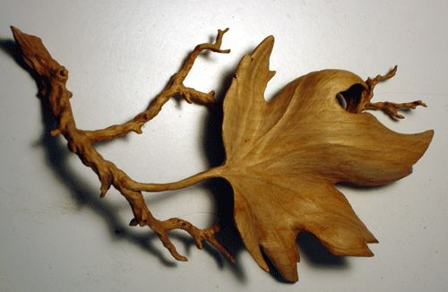Leaf carving patterns power wood